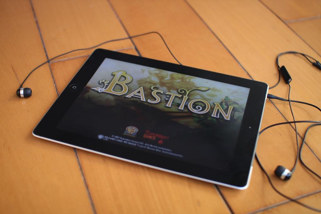 iPad, headphones and Bastion Loading screen.